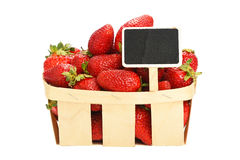 Strawberry in wooden basket with price sign Stock Photos