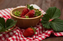 Strawberry in a wooden bowl Royalty Free Stock Image