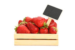 Strawberry in wooden box with price sign Stock Photography