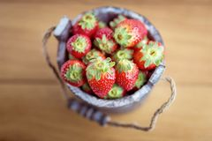 Strawberry in wooden bucket Stock Photo