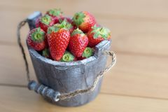 Strawberry in wooden bucket Royalty Free Stock Photography