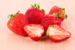 Strawberry on the wooden cutting board Royalty Free Stock Photo