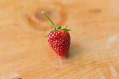 Strawberry on a wooden table. Strawberry on a wooden table Royalty Free Stock Photos