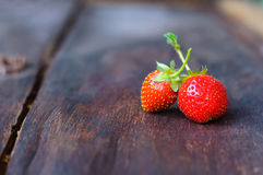 Strawberry on wooden table. Strawberry on old wooden table Royalty Free Stock Image