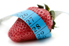 Strawberry wrapped around a measurement tape stock images