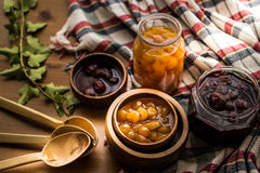 Strawberry and Yellow Cherry Jam with a Rustic Tablecloth. stock photo