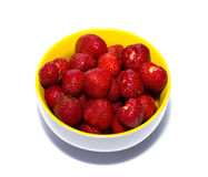Strawberry in a yellow soup plate Stock Photos