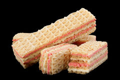 Strawberry yellow wafer on black Stock Image