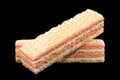 Strawberry yellow wafer on black Royalty Free Stock Photography