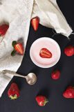 Strawberry yoghurt and bowl with strawberies Royalty Free Stock Photography