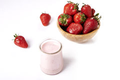 Strawberry yoghurt and bowl with strawberies Stock Photos