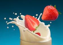 Strawberry in yogurt Stock Photos