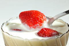 Strawberry with yogurt Stock Photos