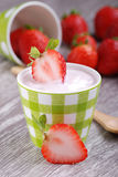 Strawberry yogurt. With fruit pieces royalty free stock photo