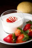 Strawberry yogurt. Yummy yogurt with strawberry topping stock photography