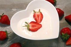 Strawberry yogurt in bowl with fresh strawberries Stock Photos