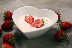 Strawberry yogurt in bowl with fresh strawberries Stock Image