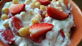 Strawberry with yogurt Stock Images