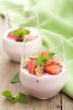 Strawberry yogurt with cornflakes and mint Stock Photography