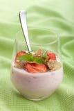 Strawberry yogurt with cornflakes and mint Royalty Free Stock Photo