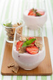 Strawberry yogurt with cornflakes and mint Royalty Free Stock Image