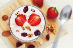 Strawberry yogurt dessert. Served with various nuts and fresh strawberries. Top view Stock Photography