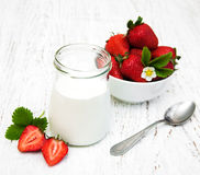 Strawberry yogurt with fresh strawberries. On a wooden background royalty free stock photos