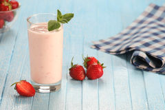 Strawberry with yogurt in a glass on a wooden background Stock Photo