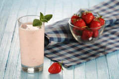 Strawberry with yogurt in a glass on a wooden background Royalty Free Stock Photography