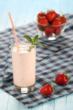 Strawberry with yogurt in a glass on a wooden background Stock Photography