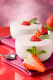 Strawberry yogurt with mint leaf Royalty Free Stock Photography
