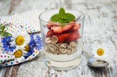 Strawberry yogurt with muesli Royalty Free Stock Photos