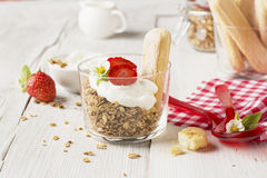 Strawberry yogurt with muesli on a old wooden background Stock Photos