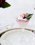 Strawberry yogurt parfait with mint. Shot inside Royalty Free Stock Image