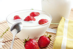 Strawberry yogurt with ripe berries. Close-up Stock Images