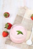 Strawberry yogurt and ripe strawberry Royalty Free Stock Photography