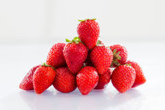 Strawberryes on a white background with reflection. Photo of Strawberryes  on a white background with reflection Royalty Free Stock Photo