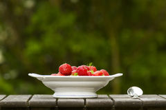 Strawberrys. Bowl with strawberrys on old wood table Royalty Free Stock Photography