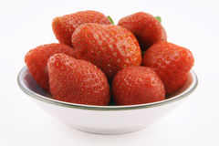 Strawberrys. In a white bowl on a white background Royalty Free Stock Photography