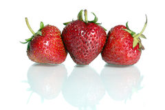 Strawberrys. Tree strawberries with reflection in the mirror Royalty Free Stock Photos