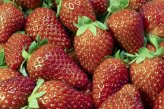 Strawberrys Closeup Background. Close-up of fresh scattered strawberrys at street market in summer background Royalty Free Stock Images
