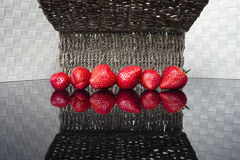 Strawberrys on glossy table. Royalty Free Stock Photo