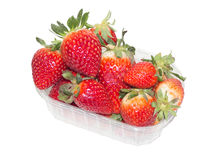 Strawberrys in plastic box on white background Royalty Free Stock Photos