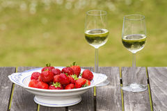 Strawberrys and white wine. On old wood table Royalty Free Stock Photo
