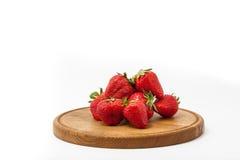Strawberrys. On wood plate white background Stock Photo