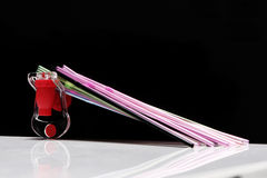 Straws on a black background. Colorful drinking straws and a fizz keeper against a black background Stock Image