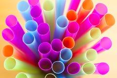 Straws. Colourful straws - purple, orange, yellow, blue Stock Image