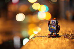Stray Robot. A robot walking on the road, after the rain Stock Image