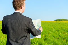 Strayed man seeking to map the way Royalty Free Stock Photo
