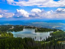 Strbske Pleso lake. Lake with blue sky and clouds royalty free stock photography